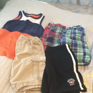 Four pairs of boys shorts and a tank top shirt